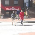 Two women crossing the street