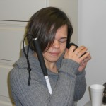 Woman Listening to Audio Recorder