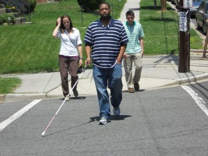 CLB client crossing at an intersection using a cane