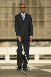 Man with White Cane Walking Down the Street