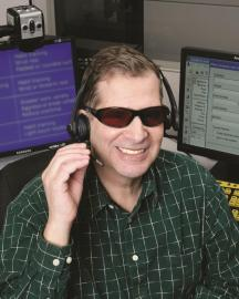 A man answering the phone at a contact center