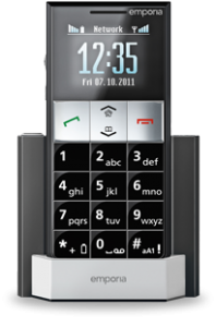 The Essence phone pictured in its charging station with the screen on