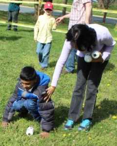 A photo of a child participating in the easter egg hunt for children with vision loss