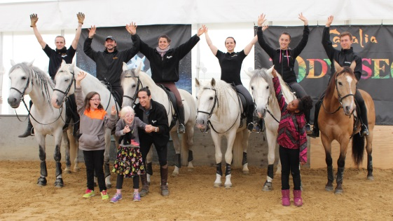 Photo of blind children with horses and their riders